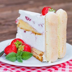 42449169 - delicious strawberry cake charlotte on a wooden background